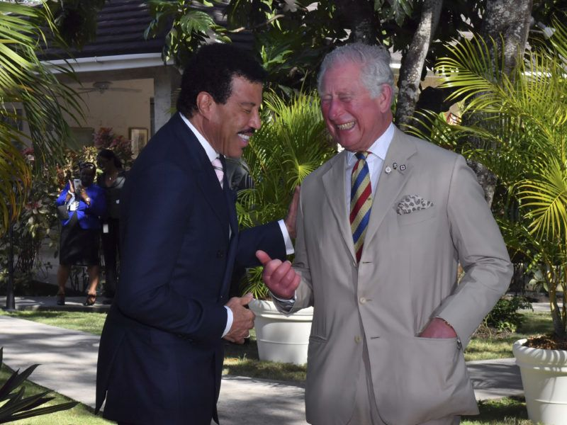 FOLKSTONE, BARBADOS - MARCH 19:  Lionel Richie and Prince Charles, Prince of Wales attend a Prince's Trust International Reception at the Coral Reef Club Hotel on March 19, 2019 in Folkestone, Barbados. The Prince of Wales and Duchess of Cornwall are visiting a number countries as part of their Caribbean Tour, including a historic visit to Cuba.  (Photo by Arthur Edwards - Pool/Getty Images)