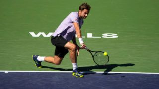 INDIAN WELLS, CALIFORNIA - MARCH 08: Stan Wawrinka of Switzerland in action against Daniel Evans of Great Britain in the first round of the men's singles on March 08, 2019 at the Indian Wells Tennis Garden in Indian Wells, California. (Photo by TPN/Getty Images)