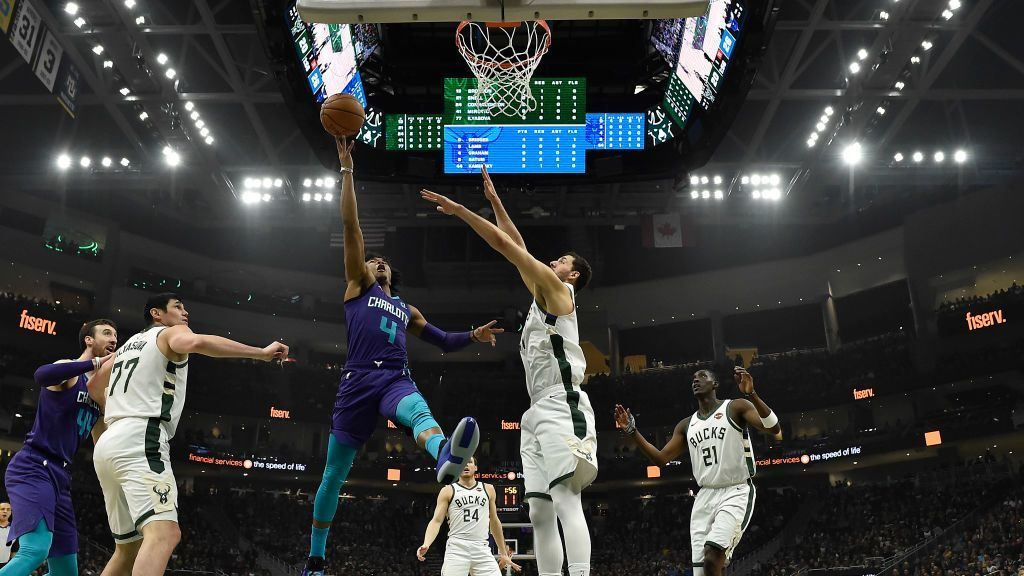 MILWAUKEE, WISCONSIN - MARCH 09: Devonte' Graham #4 of the Charlotte Hornets shoots a lay up against Nikola Mirotic #41 of the Milwaukee Bucks at Fiserv Forum on March 09, 2019 in Milwaukee, Wisconsin.  NOTE TO USER: User expressly acknowledges and agrees that, by downloading and or using this photograph, User is consenting to the terms and conditions of the Getty Images License Agreement.  (Photo by Quinn Harris/Getty Images)