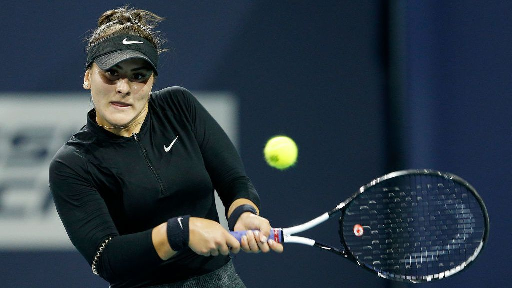 MIAMI GARDENS, FLORIDA - MARCH 23:  Bianca Andreescu of Canada returns a shot to Angelique Kerber of Germany during Day 6 of the Miami Open Presented by Itau at Hard Rock Stadium on March 23, 2019 in Miami Gardens, Florida. (Photo by Michael Reaves/Getty Images)