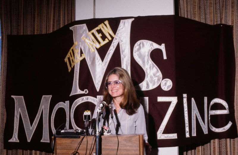 American women's rights activist and author Gloria Steinem speaks from a podium at a press conference about Ms magazine, which she co-founded, 1980s.  (Photo Robert R. McElroy/Getty Images)