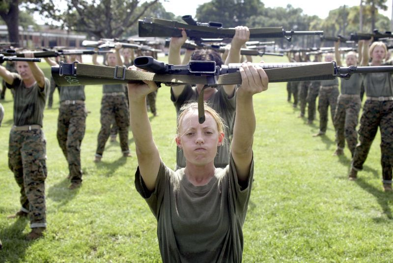 PARRIS ISLAND, SC - JUNE 23:  Female Marine Corps recruit Kylieanne Fortin, 20, of Williamsport, Maryland goes through close combat training at the United States Marine Corps recruit depot June 23, 2004 in Parris Island, South Carolina. Marine Corps boot camp, with its combination of strict discipline and exhaustive physical training, is considered the most rigorous of the armed forces recruit training. Congress is currently considering bills that could increase the size of the Marine Corps and the Army to help meet US military demands in Iraq and Afghanistan.  (Photo by Scott Olson/Getty Images)