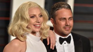 BEVERLY HILLS, CA - FEBRUARY 28:  Actor Taylor Kinney and recording artist Lady Gaga arrive at the 2016 Vanity Fair Oscar Party Hosted By Graydon Carter at Wallis Annenberg Center for the Performing Arts on February 28, 2016 in Beverly Hills, California.  (Photo by Axelle/Bauer-Griffin/FilmMagic)