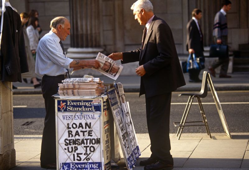 A city worker buys a copy of the Evening Standard with a headline relating to the ERM crisis in 1992, known as Black Wednesday which referred to the events of 16 September 1992 when the British Conservative government was forced to withdraw the pound sterling from the European Exchange Rate Mechanism (ERM) after they were unable to keep it above its agreed lower limit. George Soros, the most high profile of the currency market investors, made over US$1 billion profit by short selling sterling. I (Photo by In Pictures Ltd./Corbis via Getty Images)