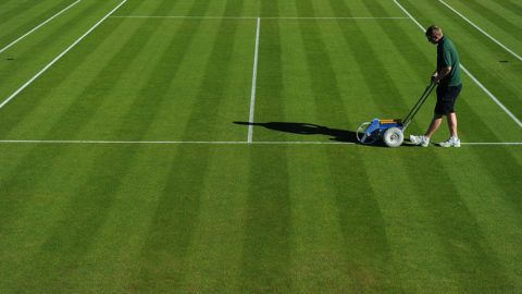 All England Club ground staff prepare one of the grass courts for the start of play on Day Two of the 2015 Wimbledon Lawn Tennis Championships at the All England Lawn Tennis and Croquet Club in London, UK. (Photo by Ben Radford/Corbis via Getty Images)
