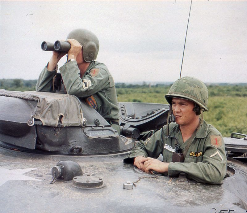 Two American soldiers survey a forward area from the top of an M48 Patton tank during a road reconnaissance, Vietnam, October 1965. (Photo by PhotoQuest/Getty Images)
