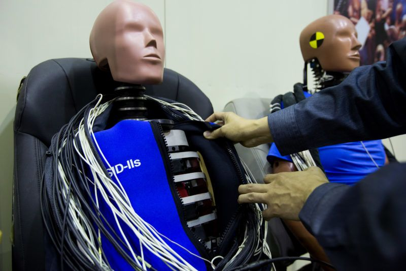 An employee inspects a crash test dummy at the Korea Automobile Insurance Repair Research and Training Center (KART), operated by the Korea Insurance Development Institute (KIDI), in Icheon, South Korea, on Wednesday, Oct. 12, 2016. KART performs research on vehicle safety to lower personal injuries from traffic accidents, reduce repair costs and provide training to insurance engineers on automobile technology and estimation, according to the company's website. Photographer: SeongJoon Cho/Bloomberg via Getty Images