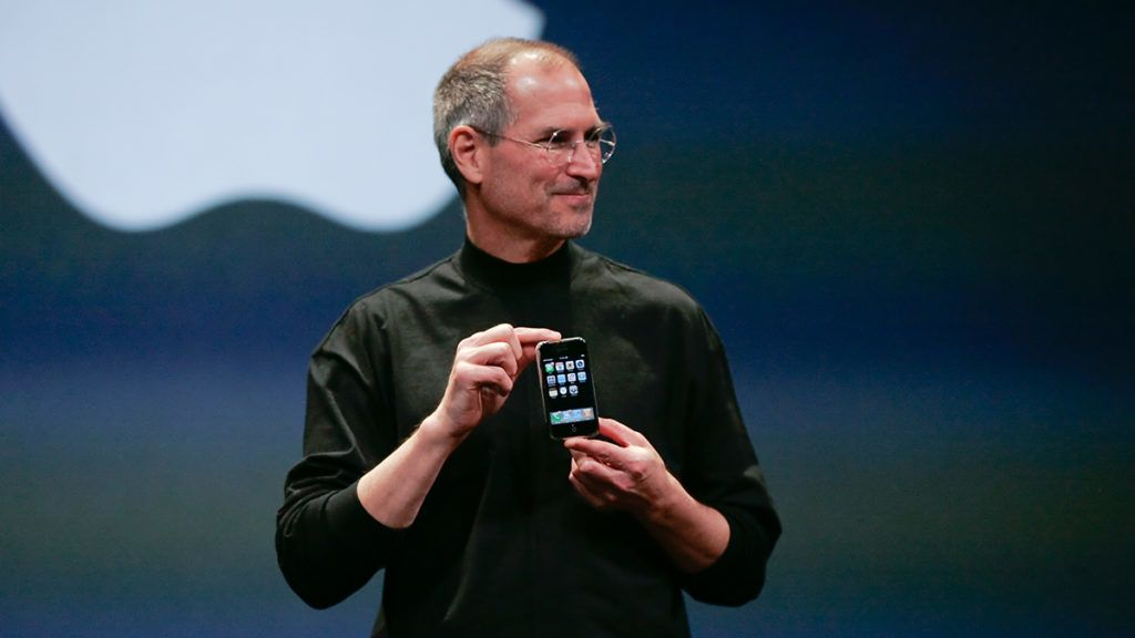 Apple Computer Inc. Chief Executive Officer Steve Jobs holds the new iPhone in San Francisco, California. (Photo by Kimberly White/Corbis via Getty Images)