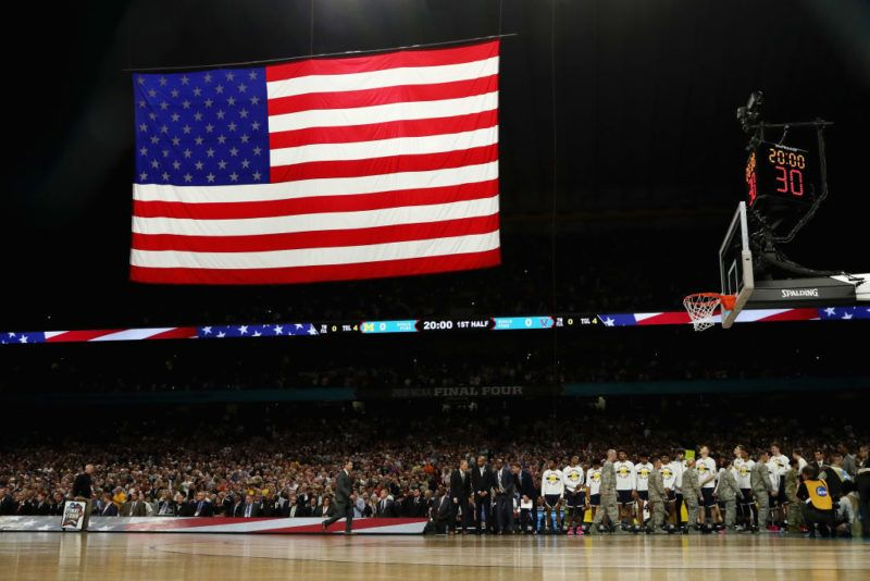 SAN ANTONIO, TX - APRIL 02:  The Michigan Wolverines look on during the national anthem before the 2018 NCAA Men's Final Four National Championship game against the Villanova Wildcats at the Alamodome on April 2, 2018 in San Antonio, Texas.  (Photo by Tom Pennington/Getty Images)