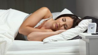Portrait of a woman sleeping deeply in a bed in the night at home or hotel room