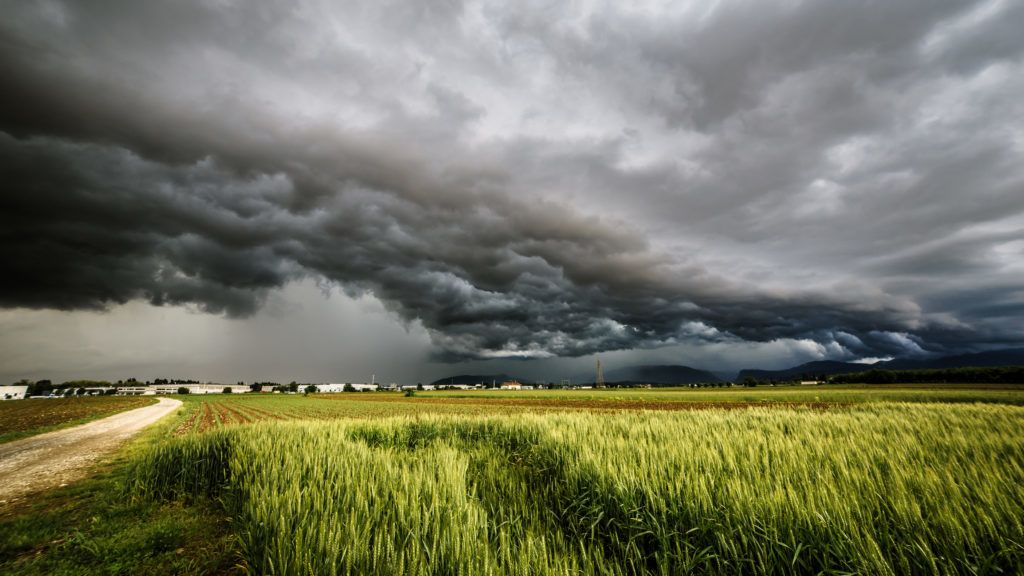 a storm is growin up over the fields of italy