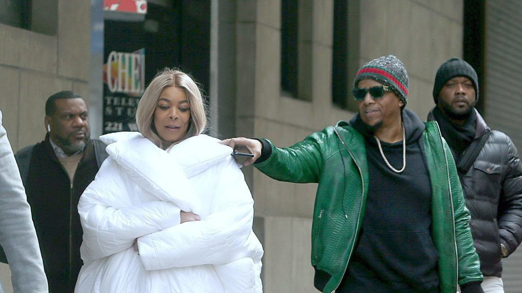 03/13/2019 EXCLUSIVE: Wendy Williams and Kevin Hunter are photographed together for the first time since Wendy's return to her talk show. The 54 year old talk show host seemed in good spirits as she stepped out of her studio in New York City wrapped in a white oversized puffer jacket, burgundy leggings, and white trainers. 