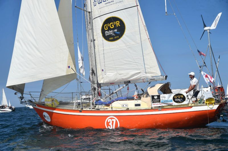 """Hungarian born and US Istvan Kopar on his boat """"Puffin"""" competes from Les Sables d'Olonne Harbour on July 1, 2018, at the start of the solo around-the-world """"Golden Globe Race"""" ocean race in which sailors compete without high technology aides such as GPS or computers. - Nineteen sailors are travelling nonstop without assistance and without touching shore for about nine months, replicating a 1968 race that produced only one finisher, Britain's Sir Robin Knox-Johnston who was the only entrant to complete the race, becoming the first person to sail single-handed and non-stop around the world. (Photo by JEAN-FRANCOIS MONIER / AFP)"""