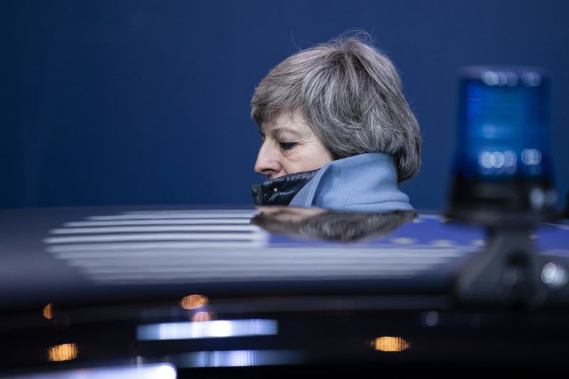 British Prime Minister Theresa May leaves a European Council meeting on Brexit at The Europa Building at The European Parliament in Brussels on April 11, 2019. - European leaders agreed with Britain on Thursday to delay Brexit by up to six months, saving the continent from what could have been a chaotic no-deal departure at the end of the week. The deal struck during late night talks in Brussels means that if London remains in the EU after May 22, British voters will have to take part in European elections. (Photo by KENZO TRIBOUILLARD / AFP)