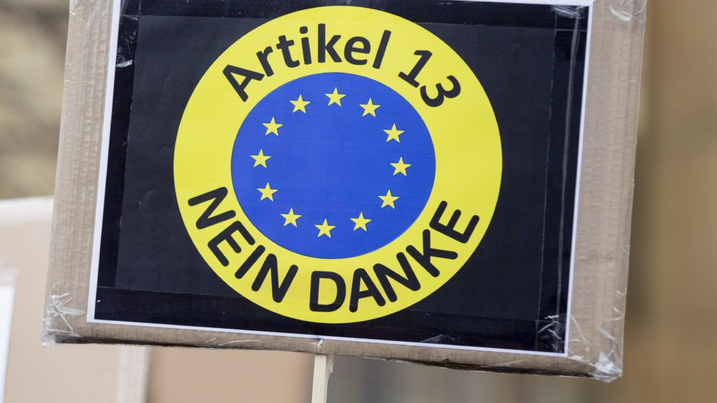 """02 March 2019, Berlin: """"Article 13 no thanks"""" is written on a poster at a demonstration of the alliance """"Berlin gegen 13"""" against upload filters and EU copyright reform in Article 13. Photo: Christoph Soeder/dpa"""