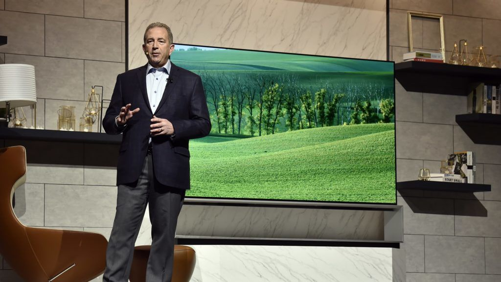 LAS VEGAS, NEVADA - JANUARY 07: LG Electronics USA Senior Director of Home Entertainment Product Marketing Tim Alessi unveils a LG OLED 8K TV during a LG press event for CES 2019 at the Mandalay Bay Convention Center on January 7, 2019 in Las Vegas, Nevada. CES, the world's largest annual consumer technology trade show, runs from January 8-11 and features about 4,500 exhibitors showing off their latest products and services to more than 180,000 attendees.   David Becker/Getty Images/AFP