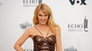 Australian singer Kylie Minogue poses during a photocall upon arrival for the 2018 Echo Music Awards ceremony on April 12, 2018 in Berlin. (Photo by AXEL SCHMIDT / AFP)