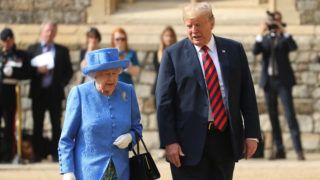 "US President Donald Trump (R) and Britain's Queen Elizabeth II (L) leave the Quadrangle after inspecting a Guard of Honour during a ceremonial welcome at Windsor Castle in Windsor, west of London, on July 13, 2018 on the second day of Trump's UK visit. - US President Donald Trump on Friday played down his extraordinary attack on Britain's plans for Brexit, praising Prime Minister Theresa May and insisting bilateral relations ""have never been stronger"", even as tens of thousands protested in London against his visit. (Photo by Chris Jackson / POOL / AFP)"