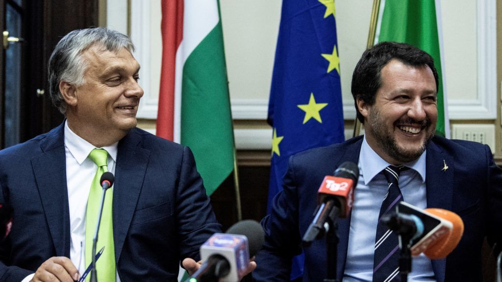 Italy's Interior Minister Matteo Salvini (R) and Hungary's Prime Minister Viktor Orban share a light moment as they address a press conference following a meeting in Milan on August 28, 2018. (Photo by MARCO BERTORELLO / AFP)