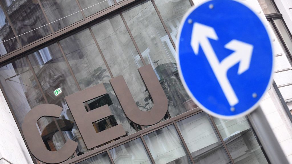 """The logo of the Central European University (CEU) is pictured in Budapest on December 3, 2018. - Hungary's renowned CEU announced it had been """"forced"""" to move its most prestigious studies to Vienna after a long and bitter legal battle with Prime Minister Viktor Orban's government. (Photo by ATTILA KISBENEDEK / AFP)"""