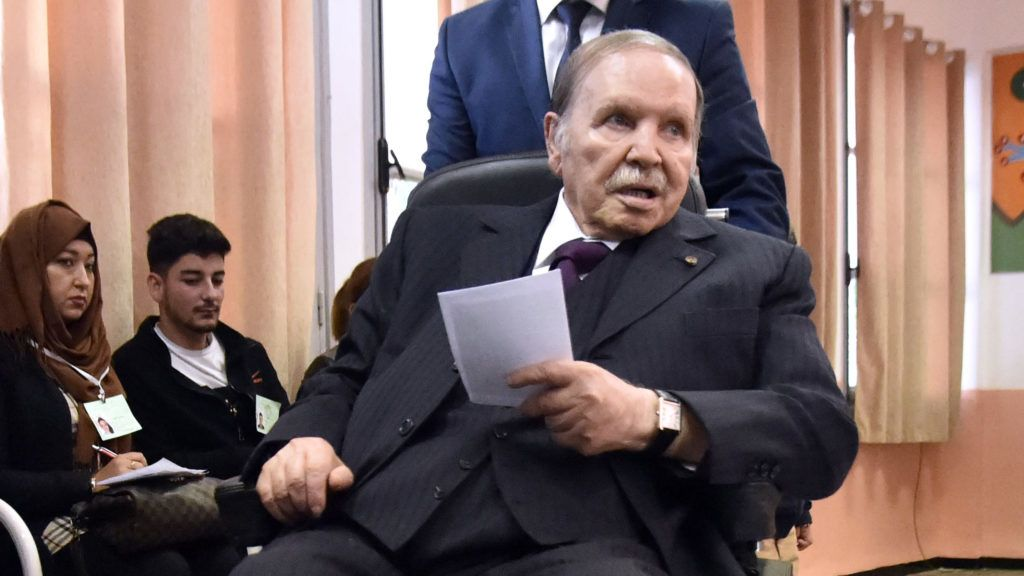 (FILES) In this file photo taken on November 23, 2017 Algerian President Abdelaziz Bouteflika is seen while voting at a polling station in the capital Algiers . - Algeria's army chief called today for  Bouteflika to be declared unfit to govern, following weeks of mass protests calling on the ailing leader to step down. (Photo by RYAD KRAMDI / AFP)