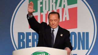 Former Italian prime minister Silvio Berlusconi gestures as he addresses a rally of right-wing Forza Italia party on March 30, 2019 at the Congress Center in Rome, ahead of the May 2019 European elections. (Photo by Andreas SOLARO / AFP)