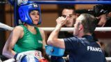 Iran's Sadaf Khadem (L) is coached by combat organiser Mahyar Monshipour (R), an Iranian-born former super bantamweight world champion, during her amateur 3 rounds boxing match against France's Anne Chauvin (R) on April 13, 2019 in Royan, western France. - Sadaf Khadem became today the first Iranian woman to contest an official boxing fight. (Photo by MEHDI FEDOUACH / AFP)
