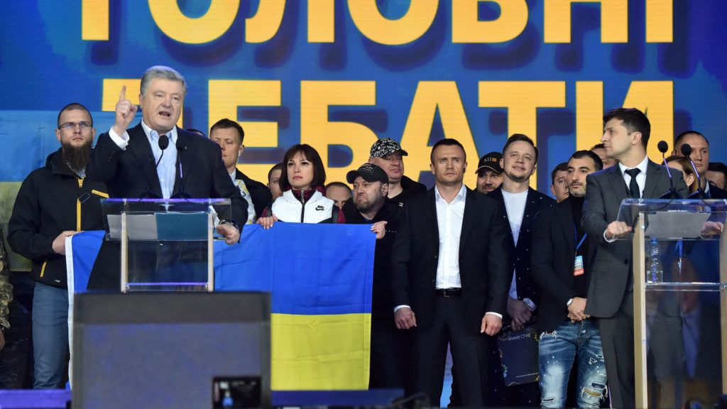 Ukrainian President Petro Poroshenko (L) speaks next to presidential candidate Volodymyr Zelensky (R) during a presidential election debate at Olimpiyski stadium in Kiev on April 19, 2019. - A comedian tipped to take over Ukraine's presidency and his incumbent rival went head-to-head in a bitter stadium debate on April 19, as campaigning reached its grand finale before a weekend vote. Polls show Volodymyr Zelensky, a 41-year-old standup comic with no political experience, handily defeating President Petro Poroshenko in a second-round of voting on April 21. (Photo by Sergei SUPINSKY / AFP)
