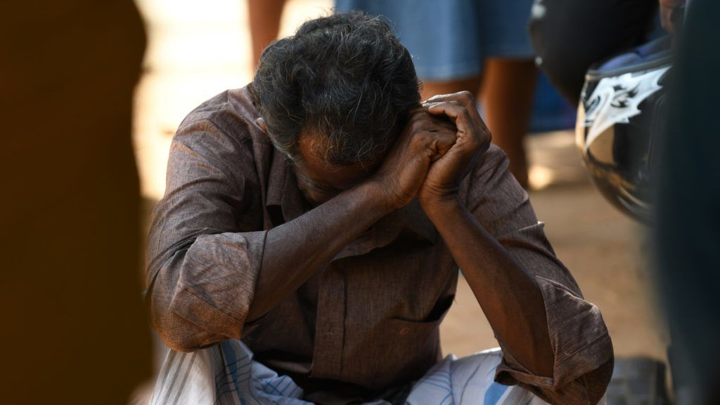 A relative of a Sri Lankan victim of an explosion at a church weeps outside a hospital in Batticaloa in eastern Sri Lanka on April 21, 2019. - A series of eight devastating bomb blasts ripped through high-end hotels and churches holding Easter services in Sri Lanka on April 21, killing nearly 160 people, including dozens of foreigners. (Photo by LAKRUWAN WANNIARACHCHI / AFP)
