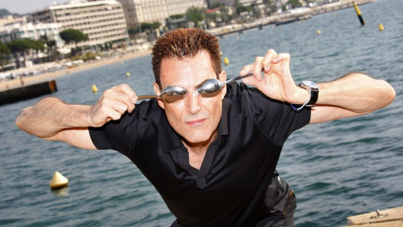 """Israeli-British hypnotizer Uri Geller poses during the photocall of """"The Successor Show"""" at the 24th edition of the five-day MIPCOM, on October 14, 2008 in Cannes, southern France. Thousands of TV content buyers are due to attend this year's international audiovisual entertainment trade show. AFP PHOTO VALERY HACHE (Photo by VALERY HACHE / AFP)"""
