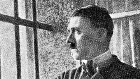 """Adolf Hitler (1889-1945), German politician, in his cell at the Landsberg am Lech prison (Bavaria, Germany), in 1924, after his attempted coup in Munich (1923). That is where he wrote """"Mein Kampf""""."""
