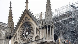 16 April 2019, France (France), Paris: Two firemen stand on the roof of Notre-Dame Cathedral in Paris. On Monday evening (15.04.2019) a fire broke out in the world-famous cathedral Notre-Dame in Paris. Above the landmark there were flames and a huge column of smoke. A small pointed tower in the middle of the roof collapsed. Photo: Marcel Kusch/dpa