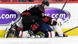 RALEIGH, NORTH CAROLINA - APRIL 18: Warren Foegele #13 of the Carolina Hurricanes knocks down Nick Jensen #3 of the Washington Capitals in the second period in Game Four of the Eastern Conference First Round during the 2019 NHL Stanley Cup Playoffs at PNC Arena on April 18, 2019 in Raleigh, North Carolina.   Grant Halverson/Getty Images/AFP