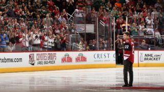 GLENDALE, AZ - APRIL 08: Former Tucson Roadrunners captain Craig Cunningham stands on the ice for the ceremonial puck drop before the NHL game between the Arizona Coyotes and the Minnesota Wild at Gila River Arena on April 8, 2017 in Glendale, Arizona. Cunningham suffered cardiac arrest on the ice during warm-ups before a Nov. 19 game with the Roadrunners, the Coyotes AHL affiliate.   Christian Petersen/Getty Images/AFP