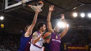 BARCELONA, SPAIN - APRIL 24:  Barcelona's Croatian centre Ante Tomic (L) vies with Anadolu Efes Istanbul's US guard Shane Larkin (C) and Barcelona's Hungarian forward Adam Hanga (L) during the Turkish Airlines EuroLeague playoff quarter-finals game between FC Barcelona Lassa and Anadolu Efes Istanbul at the Palau Blaugrana Sports Hall in Barcelona, Spain on April 24, 2019. Lola Bou / Anadolu Agency
