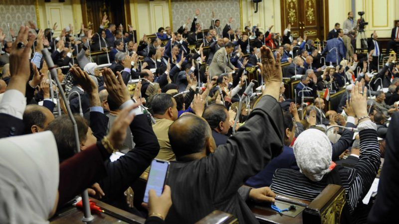 Egyptian MPs vote, during a Parliament session, on the proposed constitutional amendments that would allow President Abdel-Fattah el-Sisi to stay in power beyond 2022, when his current and final term ends. Egyptians are expected to hit the polls on 22, 23 and 24 April to vote in a popular referendum if the amendments were passed. (Photo by Mohamed Mostafa/NurPhoto)