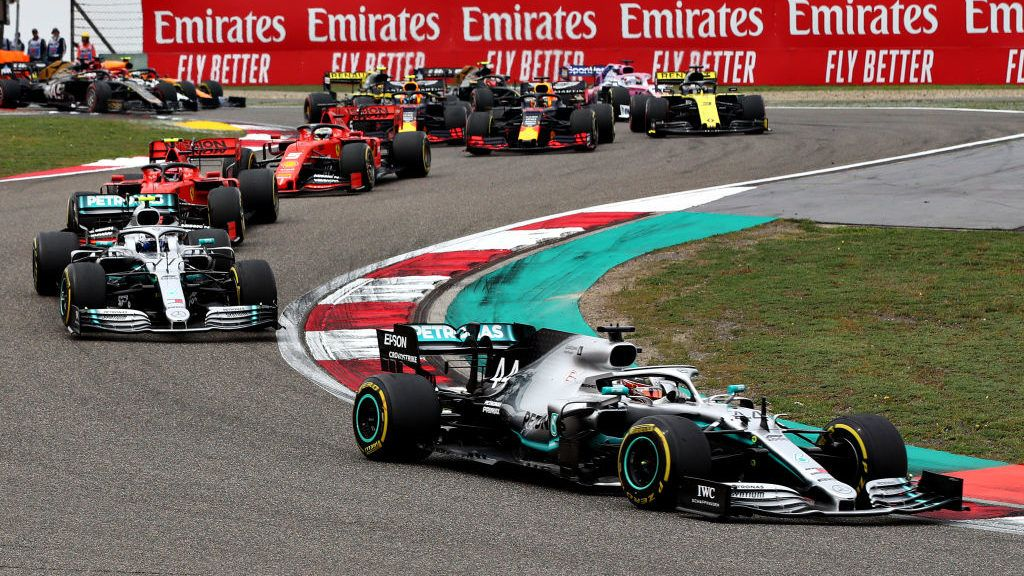 SHANGHAI, CHINA - APRIL 14: Lewis Hamilton of Great Britain driving the (44) Mercedes AMG Petronas F1 Team Mercedes W10 leads the field at the start during the F1 Grand Prix of China at Shanghai International Circuit on April 14, 2019 in Shanghai, China. (Photo by Mark Thompson/Getty Images)