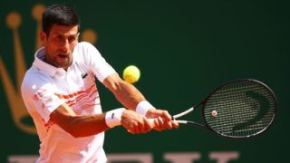 MONTE-CARLO, MONACO - APRIL 19: Novak Djokovic of Serbia plays a backhand against Daniil Medvedev of Russia in their quarter final match during day six of the Rolex Monte-Carlo Masters at Monte-Carlo Country Club on April 19, 2019 in Monte-Carlo, Monaco. (Photo by Clive Brunskill/Getty Images)