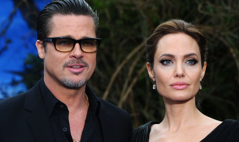 """LONDON, ENGLAND - MAY 08:  Brad Pitt and Angelina Jolie attend a private reception as costumes and props from Disney's """"Maleficent"""" are exhibited in support of Great Ormond Street Hospital at Kensington Palace on May 8, 2014 in London, England.  (Photo by Anthony Harvey/Getty Images)"""