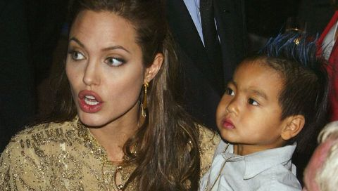 """VENICE, ITALY - SEPTEMBER 10:  Actress Angelina Jolie and her son Maddox attend the World Premiere of """"Shark Tale"""" in San Marco Square, as part of the 61st Venice Film Festival on September 10, 2004 in Venice, Italy. (Photo by Pascal Le Segretain/Getty Images)"""