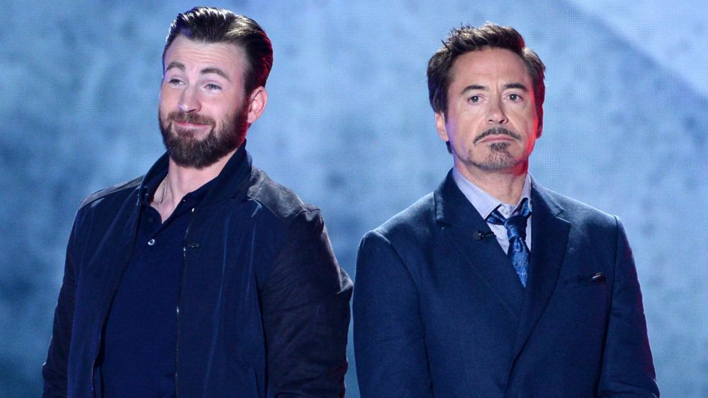 INGLEWOOD, CA - MARCH 12:  Actors Chris Evans (L) and Robert Downey Jr. speak onstage during Nickelodeon's 2016 Kids' Choice Awards at The Forum on March 12, 2016 in Inglewood, California.  (Photo by Kevin Winter/Getty Images)