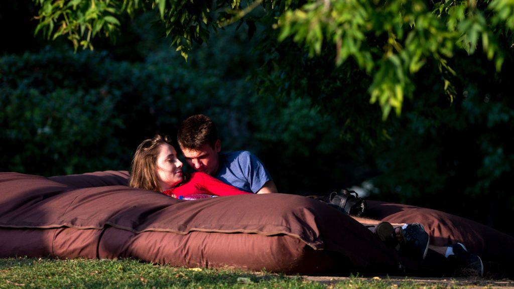 MOSCOW, RUSSIA - AUGUST 20, 2017: A couple in Gorky Park. Sergei Bobylev/TASS (Photo by Sergei BobylevTASS via Getty Images)