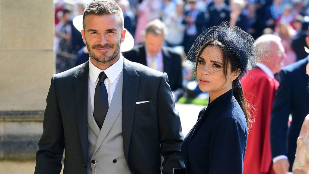 WINDSOR, UNITED KINGDOM - MAY 19: David Beckham  and Victoria Beckham arrive at St George's Chapel at Windsor Castle before the wedding of Prince Harry to Meghan Markle on May 19, 2018 in Windsor, England. (Photo by Ian West - WPA Pool/Getty Images)