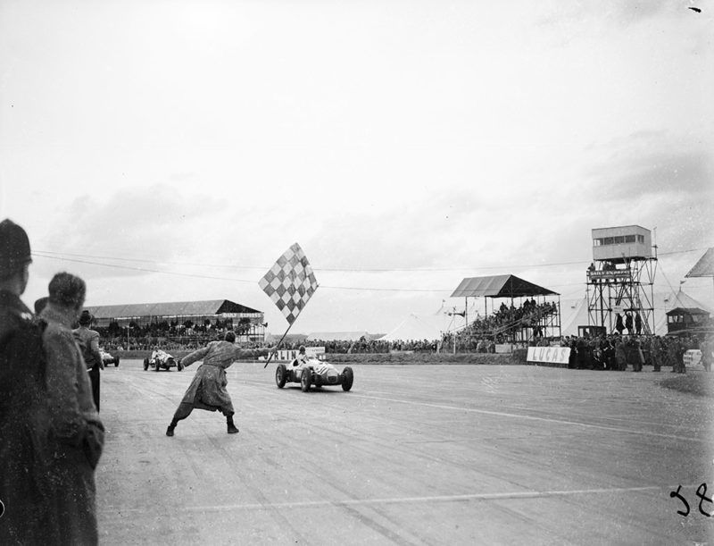 12th May 1952:  British Formula One driver Lance Macklin is flagged in the Trophy Race at Silverstone Racetrack.  (Photo by Express/Express/Getty Images)