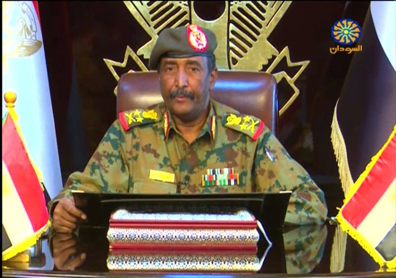 """A grab from a broadcast on Sudan TV on April 13, 2019 shows Lieutenant General Abdel Fattah al-Burhan Abdulrahman, new chief of Sudan's ruling military council, in the capital Khartoum. - Sudan's new military ruler on April 13 vowed to """"uproot"""" the regime of ousted leader Omar al-Bashir and its symbols, in a televised address to the nation. """"I announce the restructuring of state instiutions according to the law and fight corruption and uproot the regime and its symbols,"""" General Abdel Fattah al-Burhan said, a day after he was sworn in as the head of country's new ruling military council that replaced Bashir. (Photo by - / Sudan TV / AFP) / == RESTRICTED TO EDITORIAL USE - MANDATORY CREDIT """"AFP PHOTO / HO / SUDAN TV"""" - NO MARKETING NO ADVERTISING CAMPAIGNS - DISTRIBUTED AS A SERVICE TO CLIENTS =="""