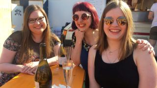 """Helen Dryden, right, with Harriet Smith, centre, and  Rosie Holme, left, drinking on bank holiday Friday in Shoreditch. See SWNS story SWTPuber; Drunk woman in London left with £300 bill after forgetting to change her home Uber setting - and ordering a cab to NEWCASTLE. Helen Dryden, 25, had enjoyed a boozy day with friends in the capital when she used her app to hail a cab - which she wanted to take her to her house in Guildford. But Helen forgot that her home Uber setting was an address in Newcastle where she went to university. She then fell asleep in the back of the cab and when she woke up an hour later she was 60 miles north - in Milton Keynes. Red-faced Helen explained her mistake and the cabbie did a U-turn and took her 75 miles back. The whole trip ending up costing her £275. Helen said: """"I couldn't believe it. The whole day ended up costing me about £400. ***EXCLUSIVE***"""