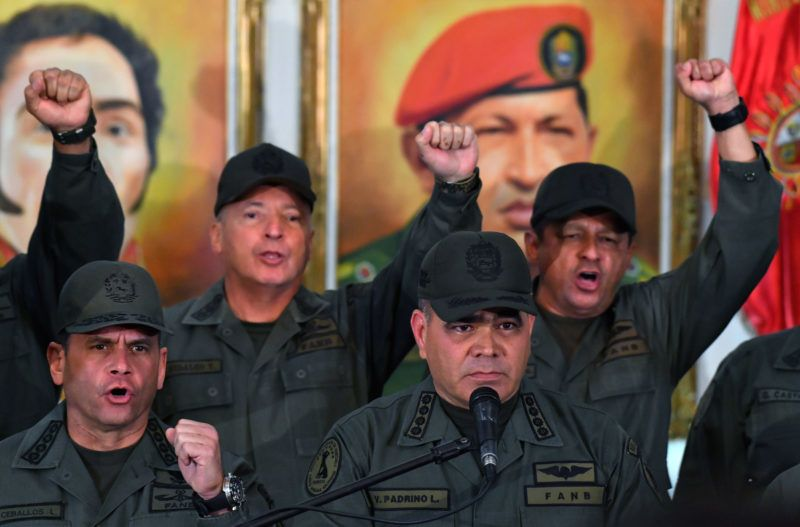 Venezuelan Defense Minister Vladimir Padrino (R) gestures surrounded by military men as he delivers a speech in Caracas on February 19, 2019. (Photo by Yuri CORTEZ / AFP)