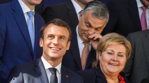 (FromL, 1st row) Lithuania's President Dalia Grybauskaite, France's President Emmanuel Macron, Norway's Prime Minister Erna Solberg, (2nd row) Sweden's Prime Minister Stefan Lofven, Poland's Prime Minister Mateusz Morawiecki, Hungary's Prime Minister Viktor Orban and Belgium's Prime Minister Charles Michel pose for a family photo on March 22, 2019 in Brussels at the end of an EU summit focused on Brexit. - European leaders and English Prime Minister agreed early on March 22 a short delay to Britain's divorce from the European Union in the hope of ensuring an orderly Brexit. (Photo by EMMANUEL DUNAND / AFP)