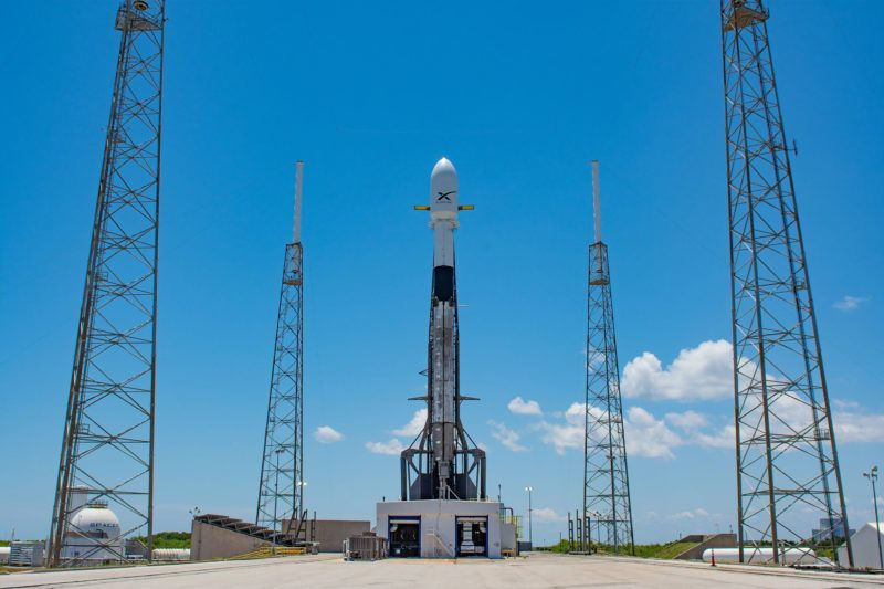 """This handout photo released by SpaceX on May 16, 2019 shows Falcon 9 ready for the second launch tentative of 60 Starlink satellites from Space Launch Complex 40 at Cape Canaveral Air Force Station in Cape Canaveral, Florida. - SpaceX postponed a launch of 60 satellites into low-Earth orbit that was scheduled for Thursday night May 16, 2019, possibly until next week, citing a need for software updates. (Photo by Handout / SPACEX / AFP) / RESTRICTED TO EDITORIAL USE - MANDATORY CREDIT """"AFP PHOTO / SPACEX """" - NO MARKETING NO ADVERTISING CAMPAIGNS - DISTRIBUTED AS A SERVICE TO CLIENTS"""