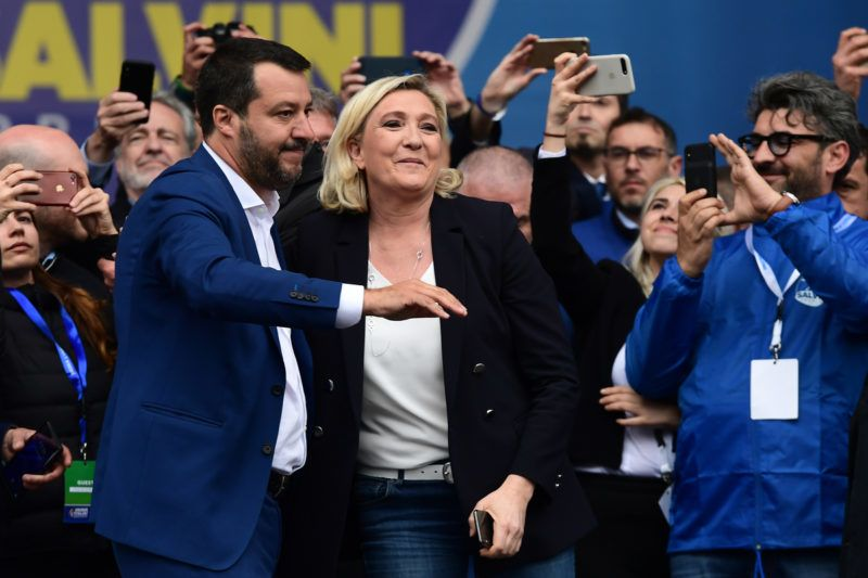 Italian Deputy Prime Minister and Interior Minister Matteo Salvini (L) and President of the French far-right Rassemblement National (RN) party Marine Le Pen react on stage at a rally of European nationalists ahead of European elections on May 18, 2019, in Milan. - The Milan rally hopes to see leaders of 12 far-right parties marching towards their conquest of Brussels after European parliamentary elections held between May 23 and 26, 2019. The headliners of Italy's League France's National Rally (RN) want their Europe of Nations and Freedom (ENF) group to become the third largest in Brussels. (Photo by Miguel MEDINA / AFP)